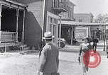 Image of Well dressed African-Americans waiting at a school near a Tennessee Emergency relief camp Tennessee USA, 1936, second 13 stock footage video 65675031562
