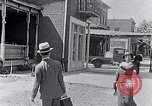 Image of Well dressed African-Americans waiting at a school near a Tennessee Emergency relief camp Tennessee USA, 1936, second 14 stock footage video 65675031562