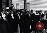Image of Well dressed African-Americans waiting at a school near a Tennessee Emergency relief camp Tennessee USA, 1936, second 23 stock footage video 65675031562