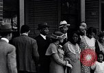 Image of Well dressed African-Americans waiting at a school near a Tennessee Emergency relief camp Tennessee USA, 1936, second 24 stock footage video 65675031562