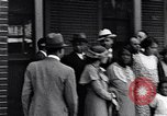 Image of Well dressed African-Americans waiting at a school near a Tennessee Emergency relief camp Tennessee USA, 1936, second 25 stock footage video 65675031562