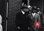 Image of Well dressed African-Americans waiting at a school near a Tennessee Emergency relief camp Tennessee USA, 1936, second 26 stock footage video 65675031562