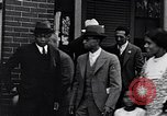 Image of Well dressed African-Americans waiting at a school near a Tennessee Emergency relief camp Tennessee USA, 1936, second 27 stock footage video 65675031562