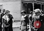 Image of Well dressed African-Americans waiting at a school near a Tennessee Emergency relief camp Tennessee USA, 1936, second 39 stock footage video 65675031562