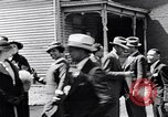 Image of Well dressed African-Americans waiting at a school near a Tennessee Emergency relief camp Tennessee USA, 1936, second 40 stock footage video 65675031562
