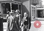 Image of Well dressed African-Americans waiting at a school near a Tennessee Emergency relief camp Tennessee USA, 1936, second 42 stock footage video 65675031562