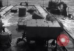 Image of Sailors chop ice from Japanese light cruiser Aleutians, 1942, second 25 stock footage video 65675031671