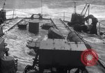 Image of Sailors chop ice from Japanese light cruiser Aleutians, 1942, second 26 stock footage video 65675031671