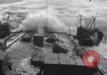 Image of Sailors chop ice from Japanese light cruiser Aleutians, 1942, second 27 stock footage video 65675031671