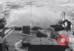 Image of Sailors chop ice from Japanese light cruiser Aleutians, 1942, second 28 stock footage video 65675031671