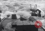 Image of Sailors chop ice from Japanese light cruiser Aleutians, 1942, second 29 stock footage video 65675031671