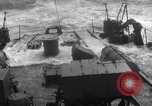 Image of Sailors chop ice from Japanese light cruiser Aleutians, 1942, second 30 stock footage video 65675031671