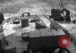 Image of Sailors chop ice from Japanese light cruiser Aleutians, 1942, second 31 stock footage video 65675031671