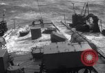 Image of Sailors chop ice from Japanese light cruiser Aleutians, 1942, second 32 stock footage video 65675031671
