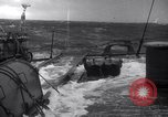 Image of Sailors chop ice from Japanese light cruiser Aleutians, 1942, second 46 stock footage video 65675031671
