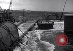 Image of Sailors chop ice from Japanese light cruiser Aleutians, 1942, second 47 stock footage video 65675031671