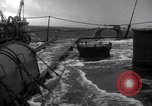 Image of Sailors chop ice from Japanese light cruiser Aleutians, 1942, second 48 stock footage video 65675031671