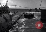 Image of Sailors chop ice from Japanese light cruiser Aleutians, 1942, second 49 stock footage video 65675031671