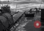 Image of Sailors chop ice from Japanese light cruiser Aleutians, 1942, second 52 stock footage video 65675031671