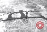 Image of Sailors chop ice from Japanese light cruiser Aleutians, 1942, second 56 stock footage video 65675031671