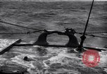 Image of Sailors chop ice from Japanese light cruiser Aleutians, 1942, second 61 stock footage video 65675031671