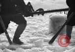 Image of Sailors chop ice from Japanese light cruiser Aleutians, 1942, second 8 stock footage video 65675031675