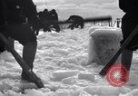 Image of Sailors chop ice from Japanese light cruiser Aleutians, 1942, second 9 stock footage video 65675031675