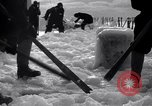 Image of Sailors chop ice from Japanese light cruiser Aleutians, 1942, second 10 stock footage video 65675031675