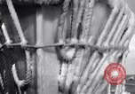 Image of Sailors chop ice from Japanese light cruiser Aleutians, 1942, second 17 stock footage video 65675031675