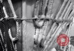 Image of Sailors chop ice from Japanese light cruiser Aleutians, 1942, second 18 stock footage video 65675031675