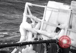 Image of Sailors chop ice from Japanese light cruiser Aleutians, 1942, second 19 stock footage video 65675031675