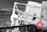 Image of Sailors chop ice from Japanese light cruiser Aleutians, 1942, second 20 stock footage video 65675031675