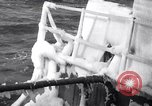 Image of Sailors chop ice from Japanese light cruiser Aleutians, 1942, second 21 stock footage video 65675031675
