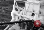 Image of Sailors chop ice from Japanese light cruiser Aleutians, 1942, second 22 stock footage video 65675031675
