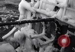 Image of Sailors chop ice from Japanese light cruiser Aleutians, 1942, second 24 stock footage video 65675031675