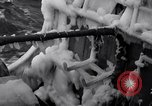 Image of Sailors chop ice from Japanese light cruiser Aleutians, 1942, second 25 stock footage video 65675031675