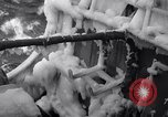 Image of Sailors chop ice from Japanese light cruiser Aleutians, 1942, second 26 stock footage video 65675031675