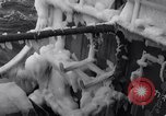 Image of Sailors chop ice from Japanese light cruiser Aleutians, 1942, second 27 stock footage video 65675031675
