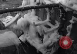 Image of Sailors chop ice from Japanese light cruiser Aleutians, 1942, second 28 stock footage video 65675031675