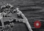 Image of Sailors chop ice from Japanese light cruiser Aleutians, 1942, second 35 stock footage video 65675031675