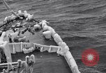 Image of Sailors chop ice from Japanese light cruiser Aleutians, 1942, second 36 stock footage video 65675031675
