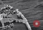 Image of Sailors chop ice from Japanese light cruiser Aleutians, 1942, second 37 stock footage video 65675031675