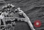 Image of Sailors chop ice from Japanese light cruiser Aleutians, 1942, second 38 stock footage video 65675031675