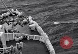 Image of Sailors chop ice from Japanese light cruiser Aleutians, 1942, second 39 stock footage video 65675031675
