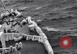 Image of Sailors chop ice from Japanese light cruiser Aleutians, 1942, second 40 stock footage video 65675031675