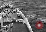 Image of Sailors chop ice from Japanese light cruiser Aleutians, 1942, second 41 stock footage video 65675031675