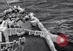 Image of Sailors chop ice from Japanese light cruiser Aleutians, 1942, second 42 stock footage video 65675031675