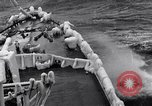 Image of Sailors chop ice from Japanese light cruiser Aleutians, 1942, second 43 stock footage video 65675031675