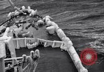 Image of Sailors chop ice from Japanese light cruiser Aleutians, 1942, second 44 stock footage video 65675031675