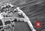 Image of Sailors chop ice from Japanese light cruiser Aleutians, 1942, second 46 stock footage video 65675031675
